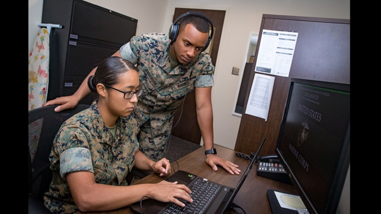 U.S. Marine Corps Sgt. Paul Anderson, right, court reporter non-commissioned officer in charge, and Lance Cpl. Christina Kim, a court reporter, both assigned to Headquarters and Headquarters Squadron, review audio files from a court case at the Legal Services building, Marine Corps Air Station Cherry Point, North Carolina, Aug. 8, 2019. Anderson and Kim are currently the only court reporters assigned to the Legal Service Support Team at Marine Corps Air Station Cherry Point (MCAS), North Carolina. (U.S. Marine Corps photo by Cpl. Micha Pierce)